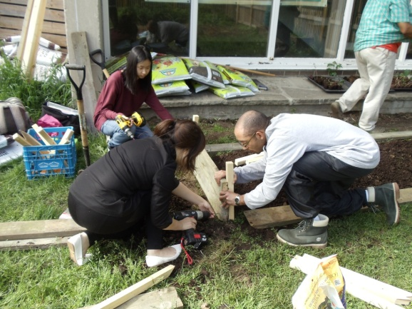 Youth with intern, building new bed at Sprucecourt PS garden